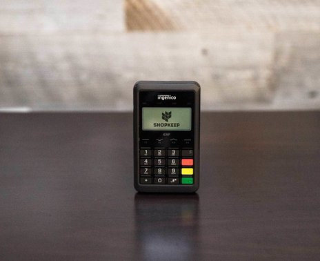 Ingenico iCMP credit card reader, head on view with ShopKeep logo on screen